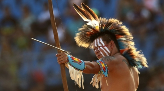 An American Indian man from the United States participates in the archery competition. (AP)