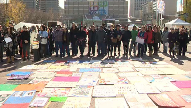 People gathered in front of City Hall on Monday to show their support of Sisters In Spirit, an organization seeking answers for the loved ones of hundreds of missing and murdered women in Canada.