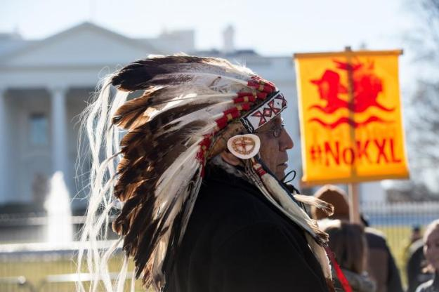 Native American advocacy groups have pushed to change Columbus Day to Native American Day or Indigenous People's Day. Pictured: Lakota spiritual leader Chief Arvol Looking Horse attended a demonstration against the proposed Keystone XL pipeline in January 2015. AFP/Getty Images