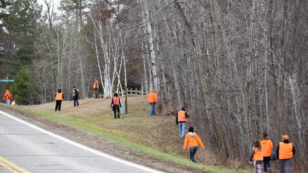 Volunteer searchers check in the ditch along Island View Drive north of Bemidji during a search Saturday organized by the family of missing woman Rose Downwind of Redby. Downwind, 31, and a mother of five, was last seen Oct. 21 leaving a residence in southeast Bemidji.