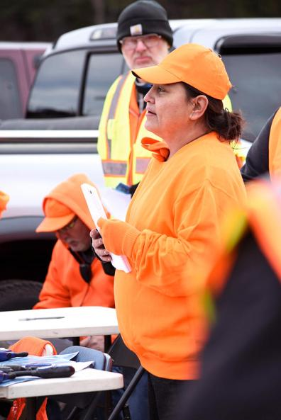 Lissa Yellowbird-Chase speaks to volunteer searchers shortly after 10 a.m. Saturday at Newby's Market. Yellowbird-Chase is the founder of Sahnish Scouts North Dakota, a Fargo-based organization that assists families of those who have gone missing.