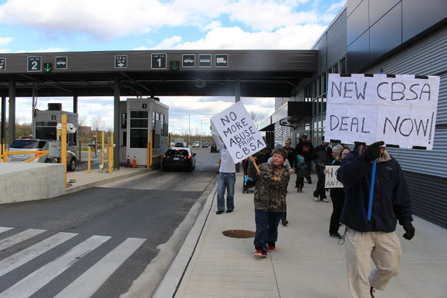 Akwesasne protesters leave the Cornwall CBSA port-of-entry building during a demonstration, Saturday.