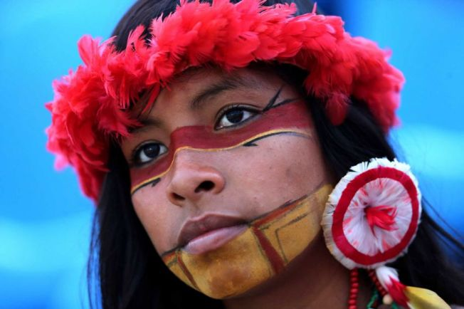 In this Oct. 28, 2015 photo, a Brazilian Pataxo indigenous woman attends the World Indigenous Games in Palmas, Brazil. Of the estimated 2,000 indigenous languages thought to have been spoken in pre-Columbian times in what is now Brazil, only around 160 survive today. Portuguese is now the first language of most members of the Pataxo nation. (Eraldo Peres/Associated Press)