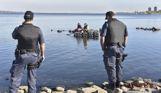 POLICE Scott Gardner,The Hamilton Spectator Activists Wendy Bush (left) and Kristen Villebrun speak to police checking on their safety Sunday as they stage a floating protest.