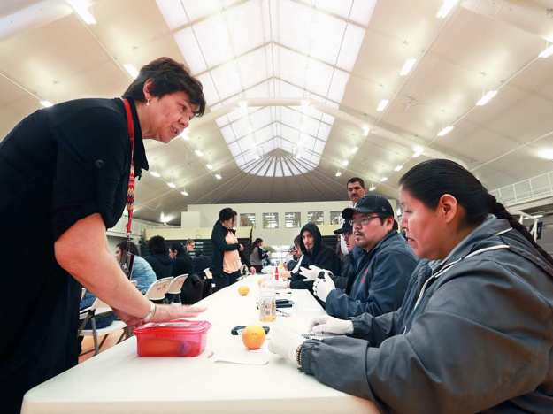 Dr. Esther Tailfeathers, left, talks with Marsha Wolfchild as she hands out take home naloxone kits in Standoff in March. GAVIN YOUNG / CALGARY HERALD