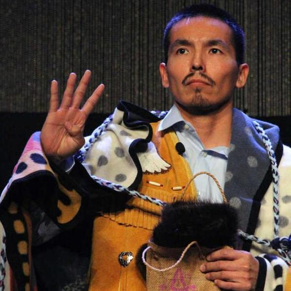 Marvin Roberts flashes four fingers in a sign of solidarity of for the Fairbanks Four following his address at the Alaska Federation of Natives conference in Anchorage on Oct. 17. Mark Thiessen | The Associated Press