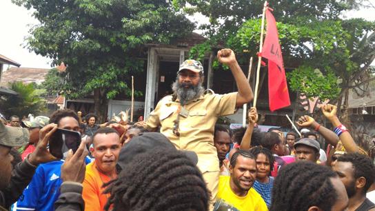 Jubilant crowds celebrate the release of prominent Papuan political prisoner Filep Karma