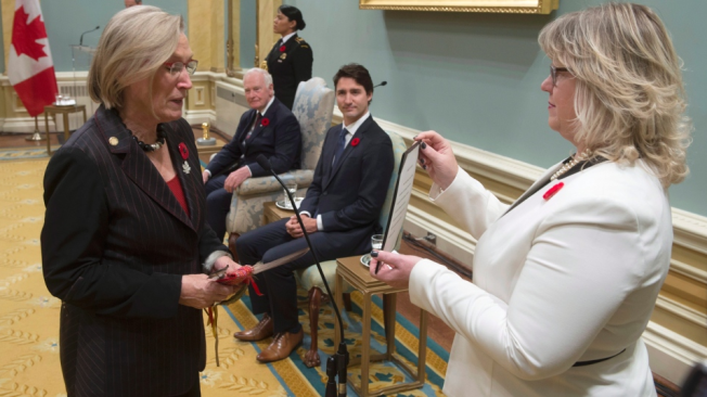Governor General David Johnston and Prime Minister Justin Trudeau look on as Carolyn Bennett is sworn in as the Minister of Indigenous and Northern Affairs during ceremonies at Rideau Hall on Nov.4, 2015 in Ottawa.(Adrian Wyld / The Canadian Press)
