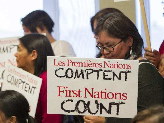 Brenda Michel of the Innu community of Mingan holds a sign at a press conference of Quebec First Nations chiefs who met in Val-d'Or north of Montreal Tuesday, October 27, 2015. They want an independent inquiry into allegations that Sûreté du Québec officers have sexually and physically abused Algonquin women while on duty. And they're demanding that the newly-elected federal Liberal government make haste on its promise to call a national inquiry into missing and murdered aboriginal women. JOHN KENNEY / MONTREAL GAZETTE