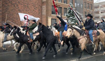 Dakota Memorial Riders: Native American horseback riders go through downtown Mankato to Reconciliation Park Saturday to honor the 38 Dakota hanged in 1862. Photo by Trevor Cokley in The Free Press.