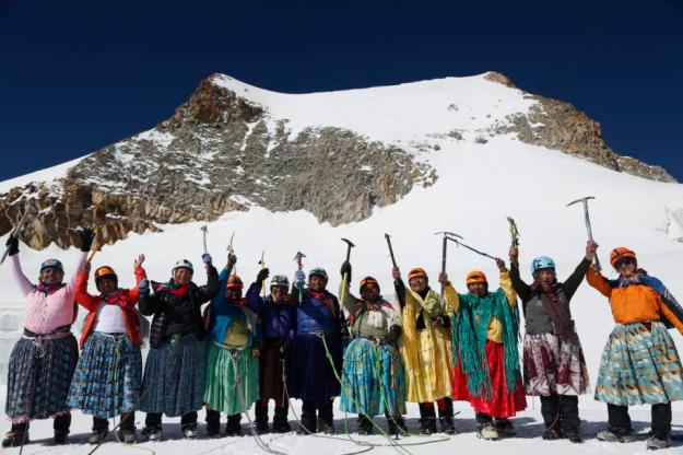 In this Dec. 16, 2015 photo, Aymara indigenous women pose for a picture as they reach the peak of the Huayna Potosi mountain on the outskirts of El Alto, Bolivia. From left are Cecilia Llusco, Juana Rufina Llusco Alana, Janet Mamani Callisaya, Domitila Alana Llusco, Marga Alana Llusco, Virginia Quispe Colque, Pacesa Llusco Alana, Lidia Huayllas, Bertha Vetia, Dora Magueno and Ana Gonzales. (AP Photo/Juan Karita)