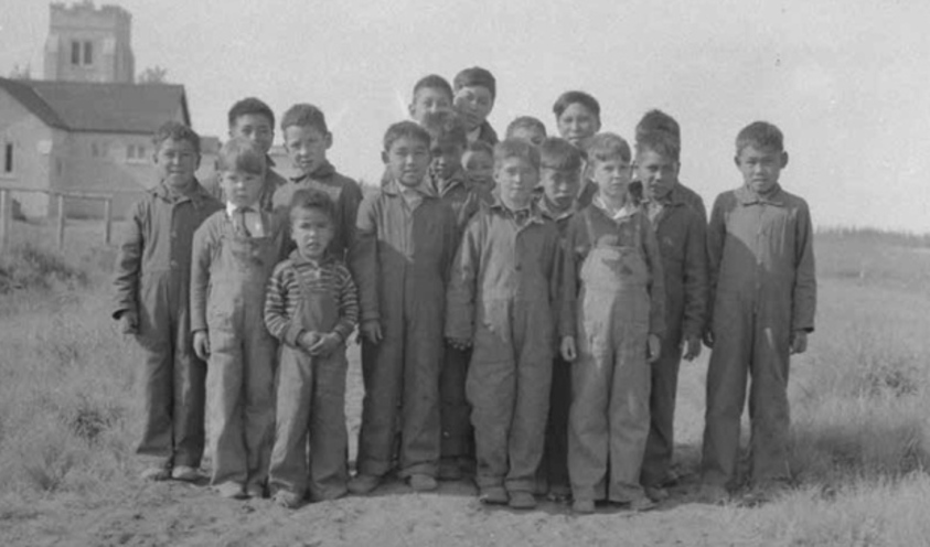 Inuit children stand outside a residential school in a photo released by the Truth and Reconciliation Commission along with its final report. (Indian and Northern Affairs, Library and Archives Canada)