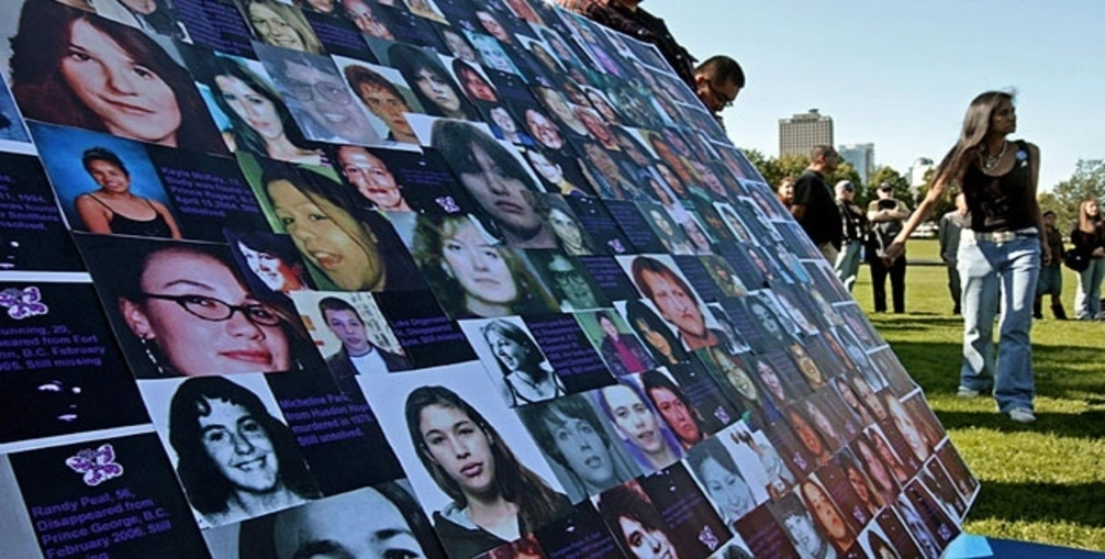 File: Photographs of missing or murdered women are displayed during a Sisters in Spirit vigil in Vancouver
