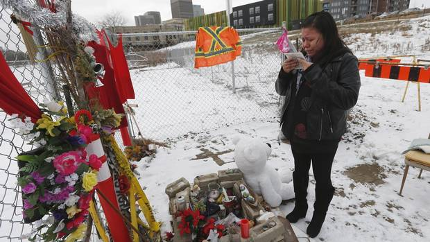 Tina Duck, the mother of Tina Fontaine, visits memorial to her daughter beside the Red River in Winnipeg on Tuesday. (JOHN WOODS/GLOBE AND MAIL)