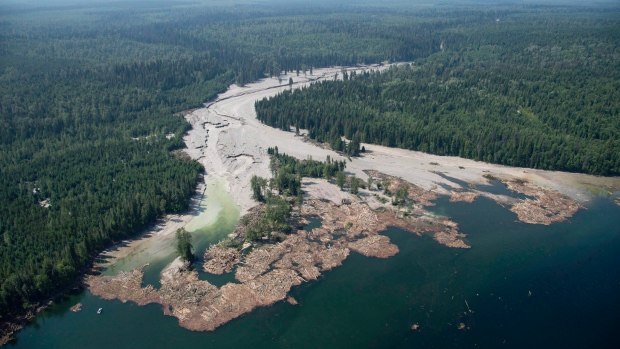 Contents from a tailings pond is pictured going down the Hazeltine Creek into Quesnel Lake near the town of Likely, B.C. on August, 5, 2014. (Jonathan Hayward/The Canadian Press)