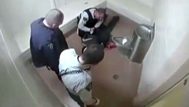 A small trail of blood can be seen in this jail video after a police officer takes Robert Wright to the ground shortly after entering the cell. (submitted by Heather Prisk)