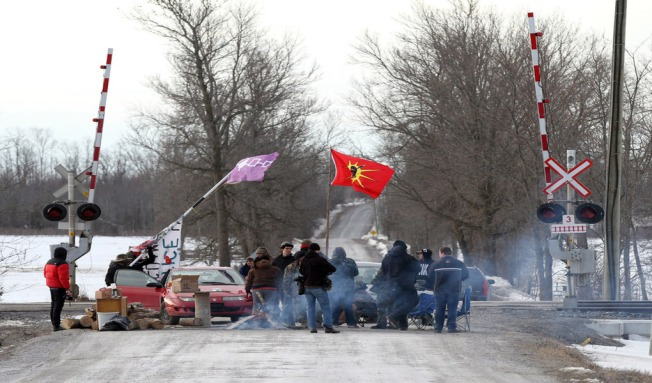 First Nations protesters block the VIA train tracks and Wyman's Road near Shannonville, Ont.