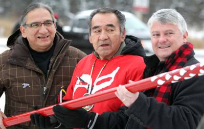 Chief Dean Sayers, of Batchewana First Nation, Emerson Riel and Sault Ste. Marie MP Terry Sheehan hold a staff dedicated to missing and murdered aboriginal women. The staff was used in a walk north of Sault Ste. Marie on Sunday, Dec. 20, 2015.