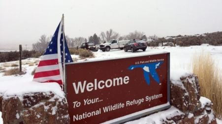 A sign of the National Wildlife Refuge System is seen at an entry of the wildlife refuge southeast of Burns, Ore., Sunday, Jan. 3, 2016. (Les Zaitz / The Oregonian)