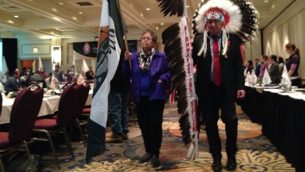 Nishnawbe Aski Nation Grand Chief Alvin Fiddler leads the grand entry for a meeting of 49 chiefs from northern Ontario in Thunder Bay, Ont., this week. (Jody Porter/CBC)