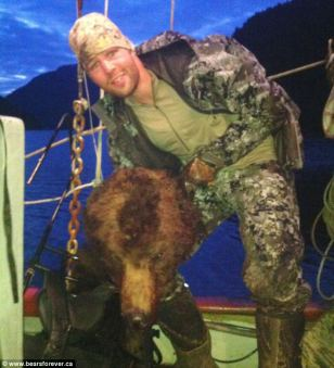Clayton Stoner, defenseman for Minnesota Wild ice hockey team, posted the photograph of him brandishing the grizzly trophy after a hunting trip last May.