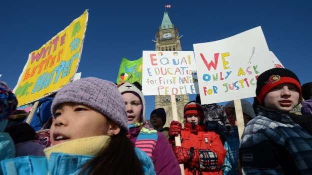 Children take part in a protest on Parliament Hill in Ottawa on Feb. 14, 2013 calling for equal education for First Nations.