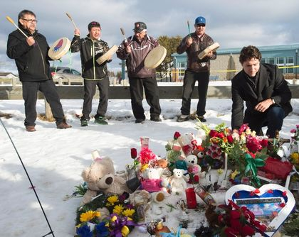 Prime Minister Justin Trudeau pauses for a moment as he lays a wreath outside the La Loche Community school in La Loche, Sask., Friday, Jan. 29, 2016. (CP/Jonathan Hayward)