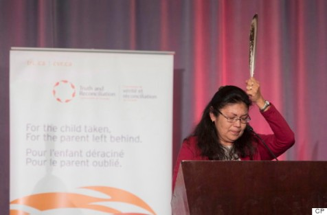 Residential school survivor Madeleine Basile holds up an eagle feather as she speaks during the release of the final report of the Truth and Reconciliation commission, Tuesday December 15, 2015 in Ottawa. (Photo: Adrian Wyld/CP)
