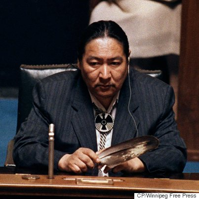 NDP MLA Elijah Harper sits in the Manitoba legislature holding an eagle feather for spiritual strength as he delays a house debate on the Meech Lake Accord on June 19, 1990. (Photo: Wayne Glowacki/Winnipeg Free Press via CP)