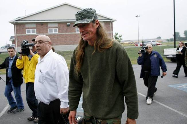 Mohawk Shawn Brant walks with lawyer, Peter Rosenthal, into the Napanee Detachment of the Ontario Provincial Police, to turn himself in on Thursday, July 5, 2007. Ryan Carter / The Globe and Mail via CP Photos