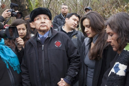 Wearing sacred red ochre paint on his face, the Union of BC Indian Chiefs' leader Grand Chief Stewart Phillip alongside Alberta's Melina Laboucan Massimo of the Lubicon Lake Cree, and Tsleil-Waututh elder Amy George, in Burnaby Mountain's conservation forest on Thursday. Photo by Mychaylo Prystupa.