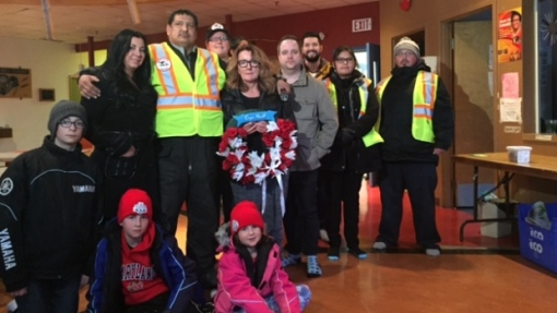 Members of the Nemeth family stand with members of the Bear Clan, a North End street patrol that helped search for Cooper Nemeth. The 17-year-old was missing for about a week before his body was found in a trash bin on Feb. 20. (Erin Brohman/CBC)