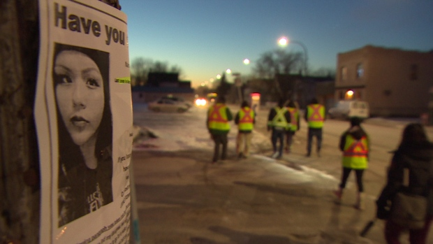 Winnipeg's Bear Clan Patrol put up posters in the North End on Thursday night. The missing 16-year-old lived in Kenora but was known to visit friends and family in Winnipeg. (CBC/Justin Fraser)