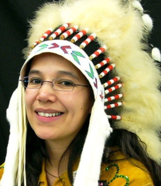 ammy Cook-Searson, chief of the Lac La Ronge Indian Band, received her headdress as a gift from the community. (Chief Tammy Cook-Searson)