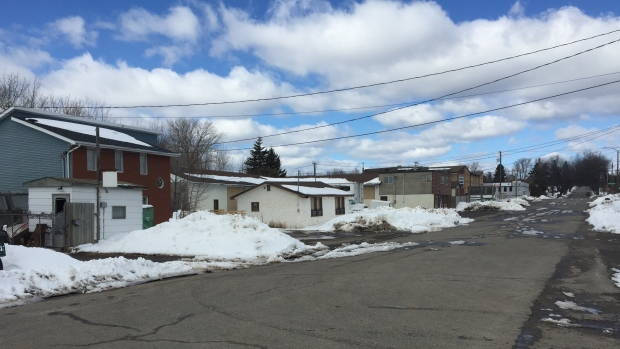 A woman was found naked and calling for help on this street near the rail tracks on the north side of Thunder Bay, Ont., around midnight on March 10. Thunder Bay police say there is no evidence to support a criminal charge. (Jody Porter/CBC)