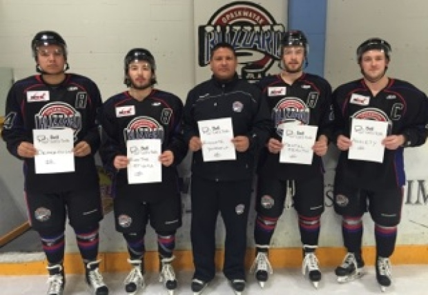 Head coach Jason Smith (middle) says taking his team to Pimicikamak to share messages of hope during their community's suicide crisis is just something he needed to do. Especially since two of his players are from the Cree community, including Brady Keeper (far left). (Jason Smith)