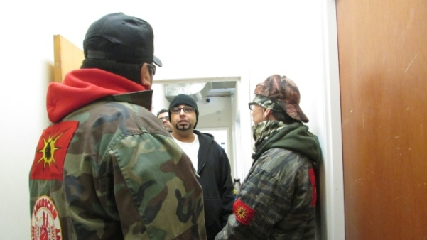 Urban Warrior Alliance members enter the Unicity Taxi offices on Hargrave Street. Calvin Clarke (right) says supervisors addressed their concerns, but workers in the office were yelling racist comments at them. (Courtesy Red Power Media)