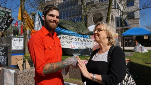 Green Party leader Elizabeth May greets Peace River Valley farmer Sage Birley at the protesters' camp outside BC Hydro on Fri. April 1, 2016. Photo by Elizabeth McSheffrey.
