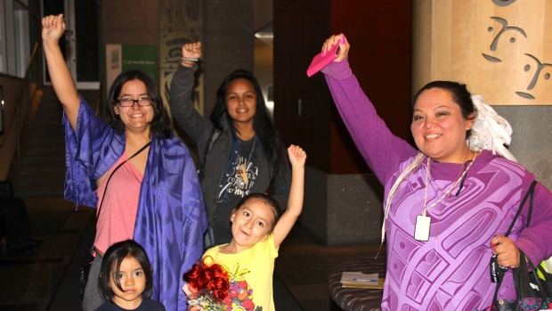 Indigenous women and children who occupied INAC offices in downtown Vancouver for one week leave the building after securing a meeting with federal ministers to discuss their demands. (Facebook)
