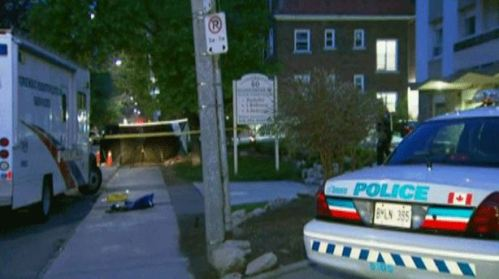 Police are shown at the scene of a suspicious death investigation on Gloucester Street near Yonge Street early Wednesday morning.
