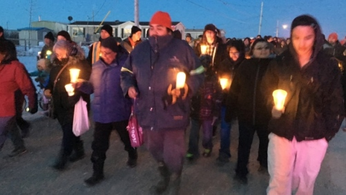 People of all ages took part in a candlelight suicide awareness walk in Attawapiskat, Ont. (Martin Trainor/CBC)