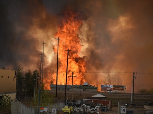 An out-of-control fire has swept into Fort McMurray, Alta., on Tuesday, forcing evacuation of the city. The out-of-control fire has burned neighbourhoods and moved into the downtown core. (Terry Reith/CBC)
