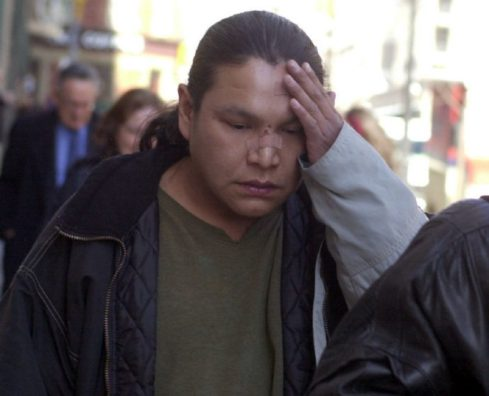 Ramsey Whitefish leaves College Park Court in 2004 after the two police officers accused of assaulting him were acquitted. The bandages on his face are the result of a recent car accident. (TONY BOCK / TORONTO STAR FILE PHOTO)