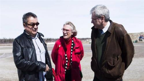Chief Bruce Shisheesh, left, Carolyn Bennett, centre, and Charlie Angus, right, meet in the northern Ontario reserve of Attawapiskat, which declared a state of emergency over a rash of suicides this spring. (Nathan Denette/Canadian Press)