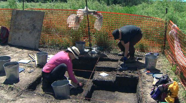 A team of archeologists are seen working at a site in Lockport, Man.
