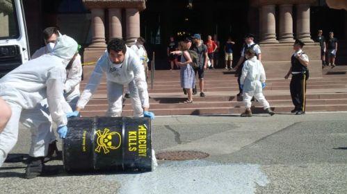 Grassy Narrows mercury protesters dump grey liquid at Queen's Park