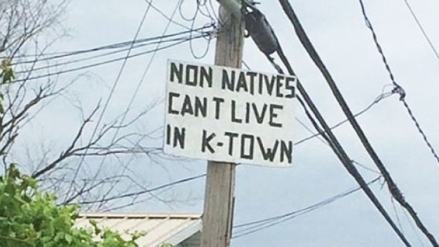 This sign is posted on a telephone pole in Kahnawake. (Submitted by anonymous Kahnawake resident)