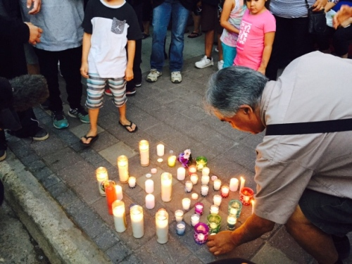 A candle is placed at a vigil for Cyril Weenusk on Wednesday evening. (Pierre Verriere/CBC)