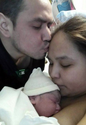 Jocelyn George with Christopher Cenname and their now four-month-old daughter. (Provided by Christopher Cenname)