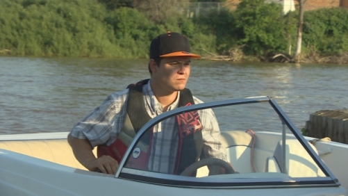 Kyle Kematch sets out on Drag the Red's new boat on Monday evening. (CBC)